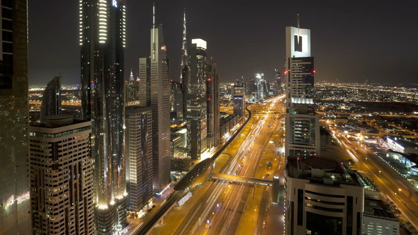 DUBAI, UNITED ARAB EMIRATES - CIRCA MAY 2011: Sheikh Zayed Rd, showing the new MTR track and station system and the Burj Khalifa, the worlds tallest building