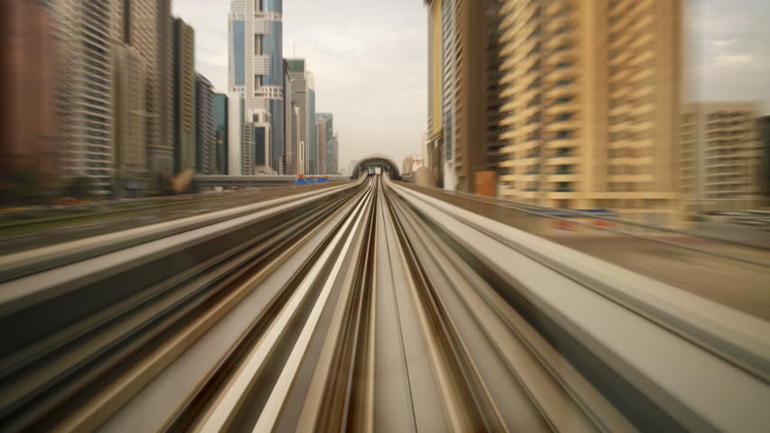 DUBAI, UNITED ARAB EMIRATES - CIRCA MAY 2011: a shot of the elevated Rail Metro System, running alongside the Sheikh Zayed Rd.