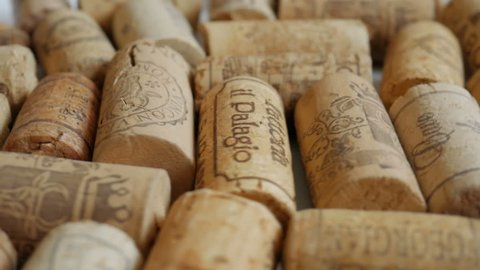 ODESSA, UKRAINE - MARCH 12, 2017: Wine corks rotates as a background. Video in slow motion of multinational corking products with shallow focus