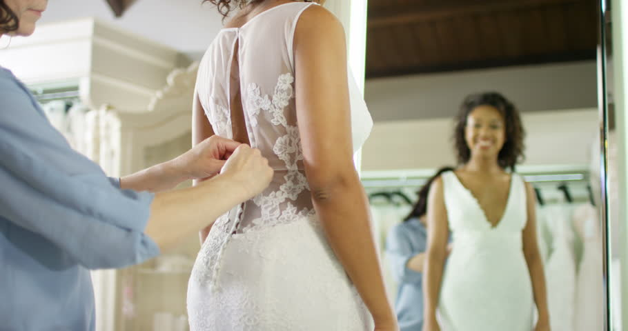 4K Beautiful Bride Trying On Her Dress In Wedding Shop Admiring Reflection The