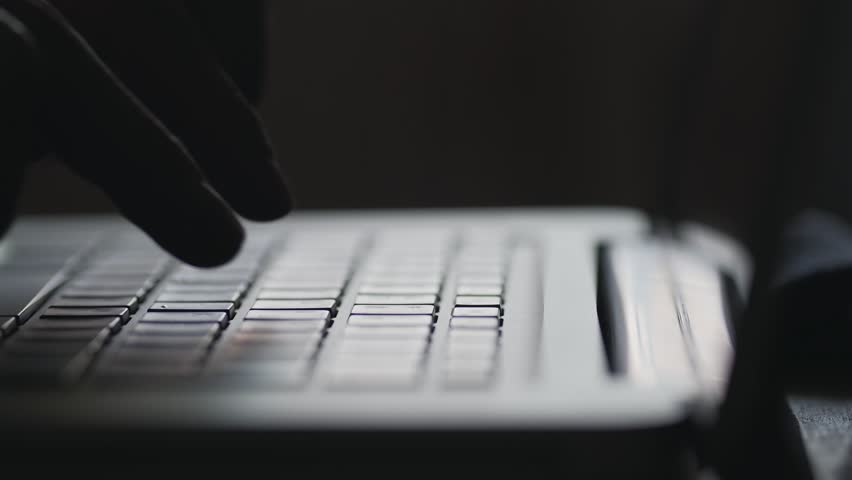 Silhouette of hands on keyboard of modern laptop. Fingers typing text. Concept of network communications. Man chatting online or looking for something in the network. Close up. Hacker hacks the site   Shutterstock HD Video #26007266