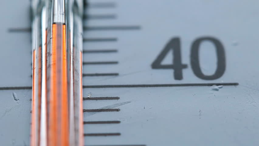 Red scale on the thermometer, close-up