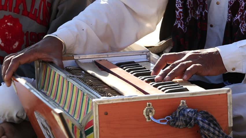 Close up shot of traditional musical instruments harmonium playing in Jaisalmer fort, Rajasthan, India