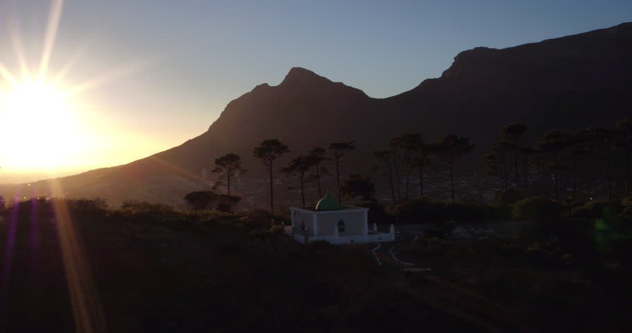Drone reveal of Cape Town during sunrise with the mosque on Signal hill in the foreground and the mother city in the background. | Shutterstock HD Video #26059676