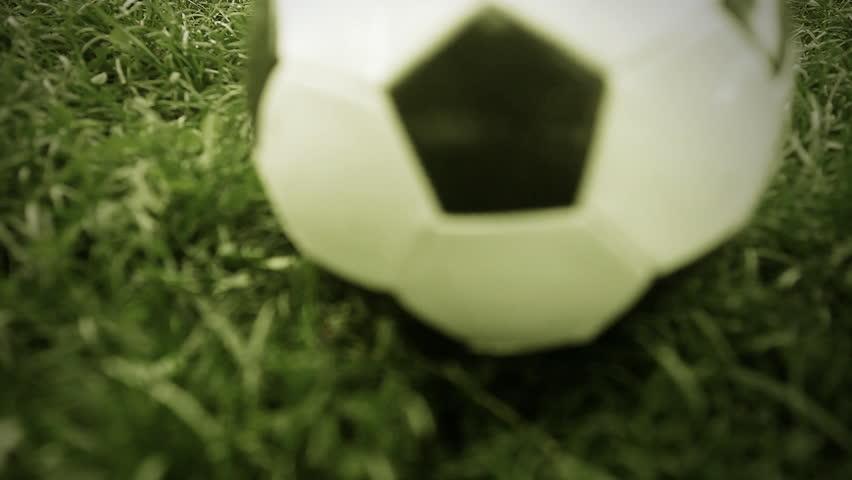 Soccer ball on the grass of football field | Shutterstock HD Video #2610866