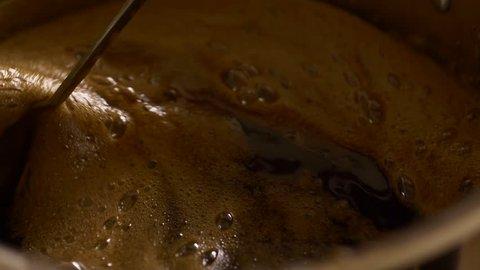Home Brew Beer making. Boiling of a dark beer liquid in slow motion 4K