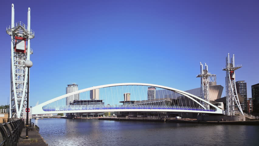 MANCHESTER, LANCASHIRE/ENGLAND - JUNE 6: Millennium Bridge opens for shipping to pass under on June 6, 2011 in Salford Quays. It is a vertical lift bridge, completed in 2000.