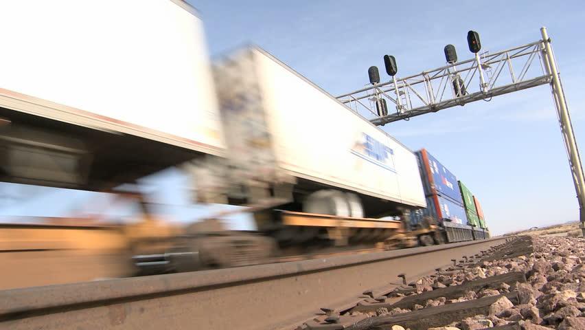 NEVADA, USA, FEB 29, 2012: Cargo train passing on railroad tracks through the dessert