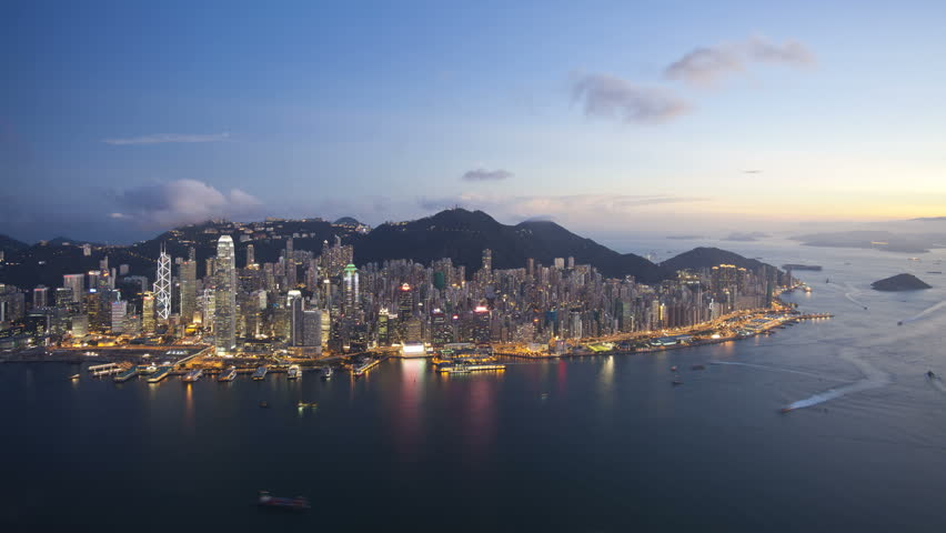 Aerial view over Hong Kong Island towards Victoria Peak showing the busy Victoria Harbour and Financial District of Central, Hong Kong, China, T/lapse | Shutterstock HD Video #2613398