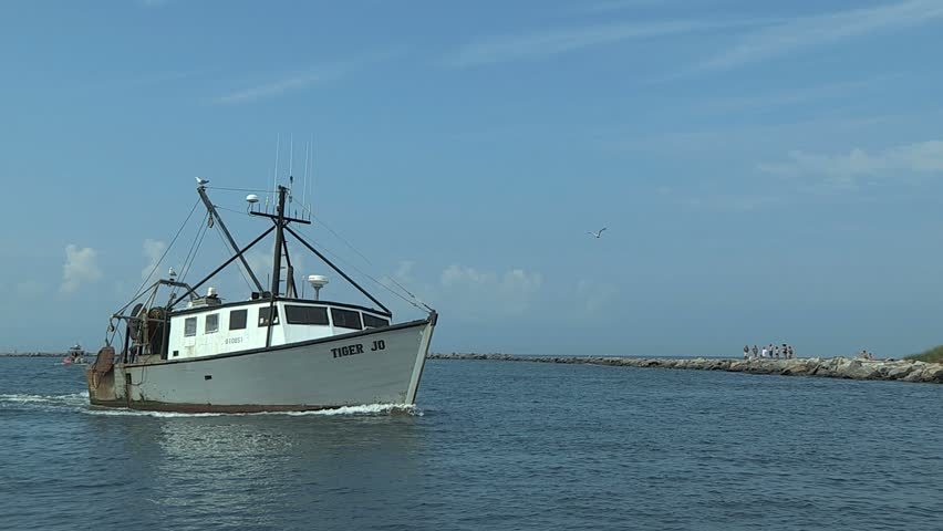 POINT JUDITH, RHODE ISLAND - CIRCA JULY 2010: Nice older white fishing boat coming into port