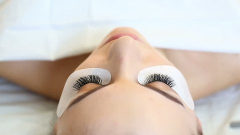 Eyelash Extension Procedure. Woman Eye with Long Eyelashes. Lashes, close up, selective focus.