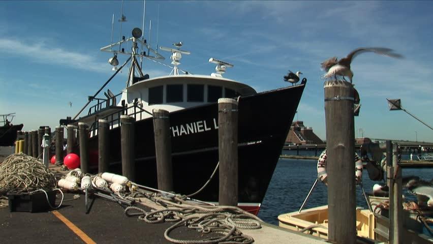 STATEN ISLAND, NEW YORK, NEW YORK  - CIRCA MAY 2006: Fishing boat at docks with sea gulls