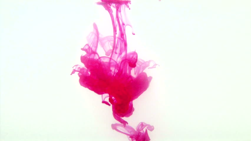 Red Food Coloring Floating In Water Against A White Background ...