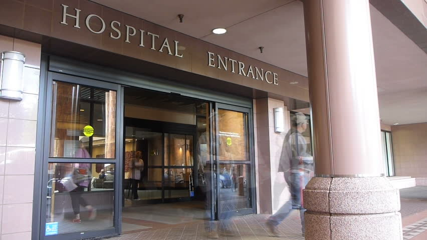 Time lapse effect at hospital entrance with patients entering and exiting