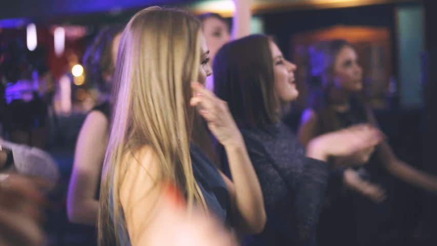 girl dances in a nightclub