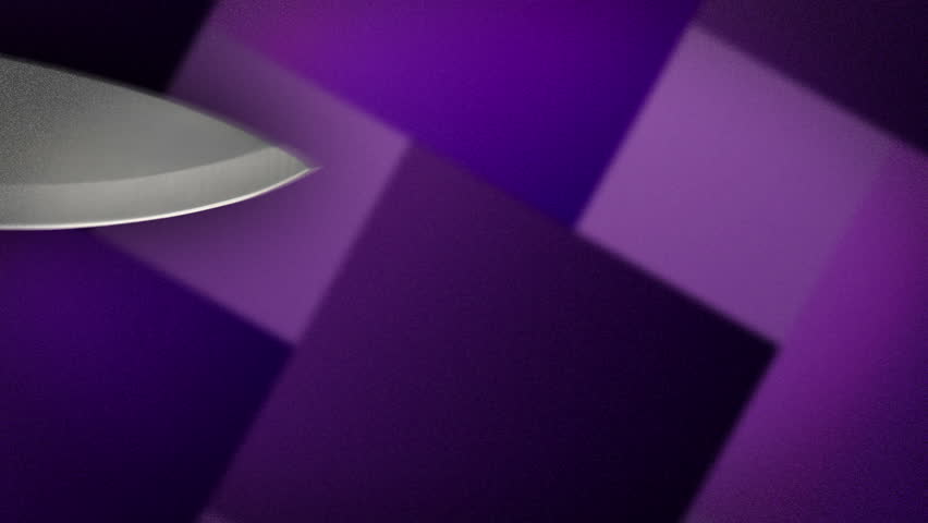A knife cutting and slicing an object off screen. | Shutterstock HD Video #2617376