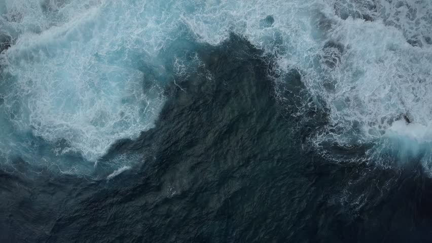 Abstract ocean water pattern of splashing waves view from above