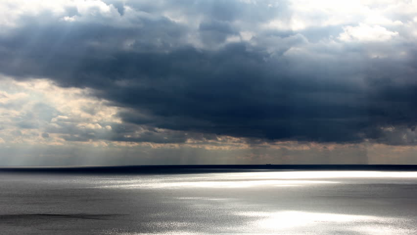 dark clouds moving over the sea