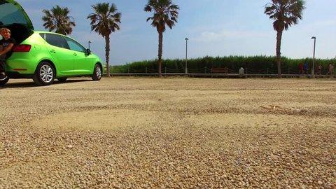 In Spain, the Mediterranean coast of the Costa Blanca, flying drone phantom 3, beach, palm trees, sun