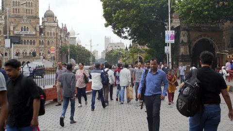 INDIA - CIRCA JUNE 2016 - Students, workers, business men, people walk on busy street, Mumbai station