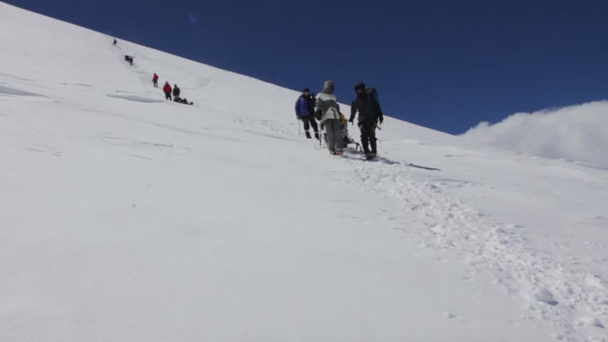 2014 07 Mount Elbrus, Russia: climbing to the top with a disabled person. | Shutterstock HD Video #26323205