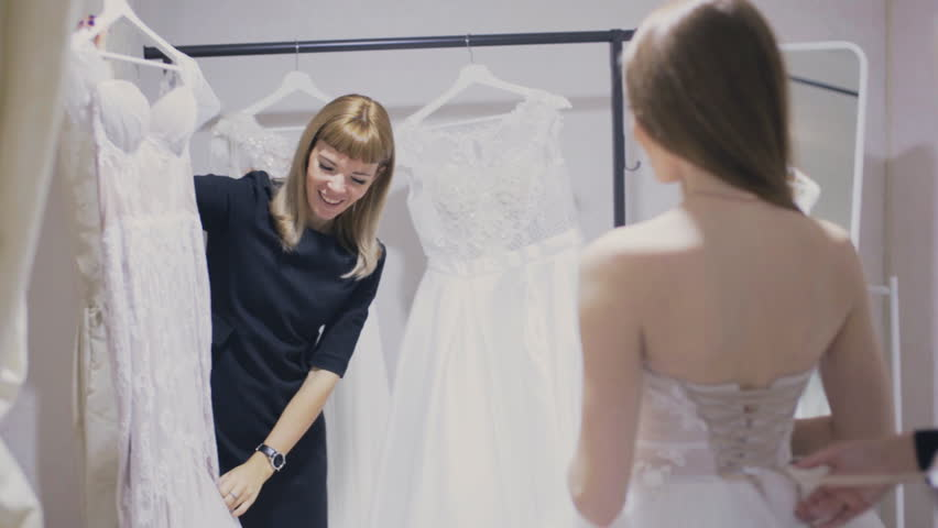Consultant Shows Wedding Gown In Bridal Shop Stock Footage Video ...