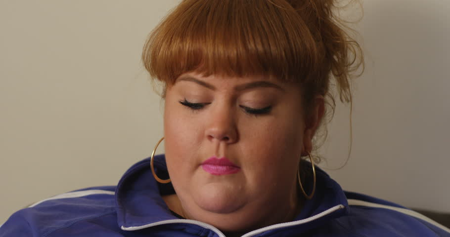 4K Happy extrovert overweight woman talking to a friend on the phone   Shutterstock HD Video #26344346