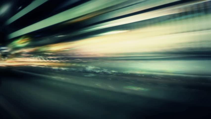 HD - Night lights streak as we travel down a city street (Loop).  Formats available: HD-NTSC-PAL