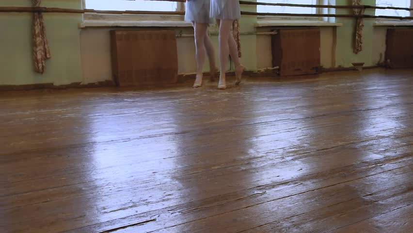 Girls In Ballet Shoes Do Exercises During Ballet Class In Frayed Classroom    HD Stock Footage