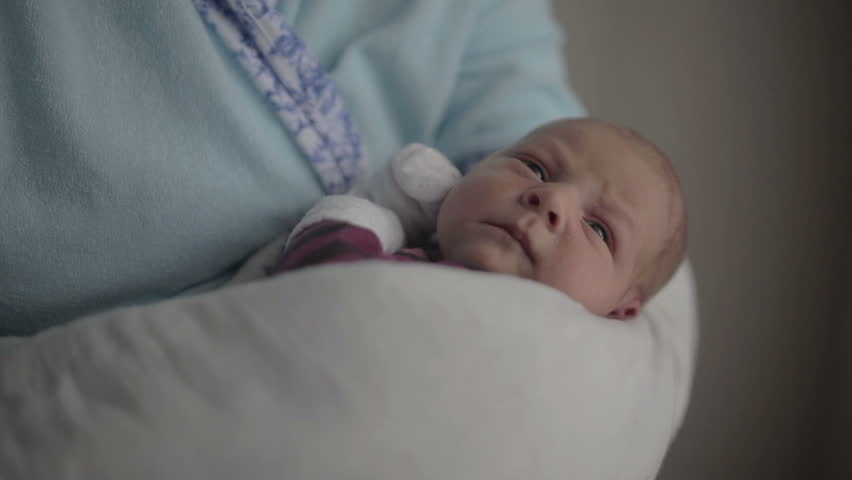 The newborn girl lying in his mother's arms and falls asleep | Shutterstock HD Video #26396366