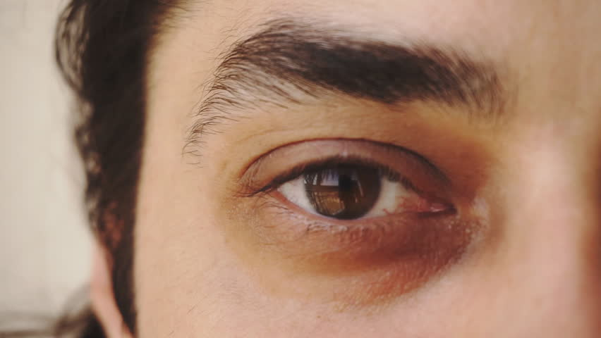 Close up of man's brown eyes looking into camera