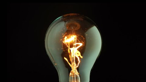 Real light bulb flickering. Incandescence thread with rotating, Macro shot