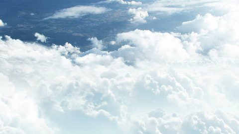 3D CGI animation of flying through white clouds towards ground visible from distance