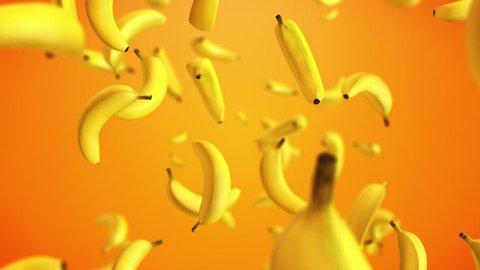 CGI 3D animation of yellow bananas floating against orange background