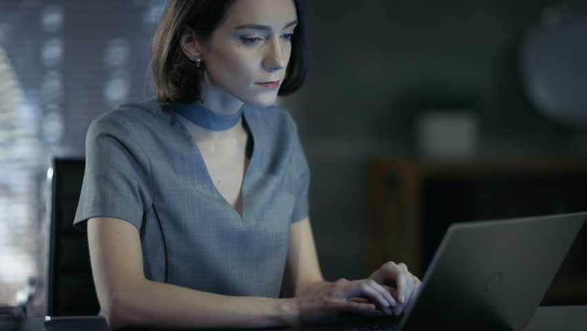 Stylish Female Top Manager Works on a Laptop in Her Private Office. Her Workspace is Modern, Done in Dark Overtones, Big City Seen out of the Window. Shot on RED EPIC-W 8K Helium Cinema Camera. | Shutterstock HD Video #26432246