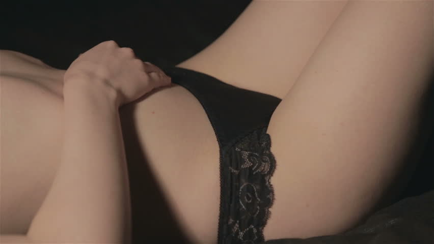 Lying woman undressing panties