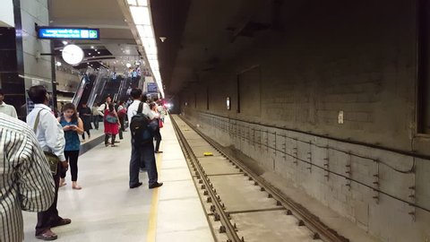 INDIA - CIRCA JUNE 2016 - Train arrives at underground metro subway station platform, New Delhi, India