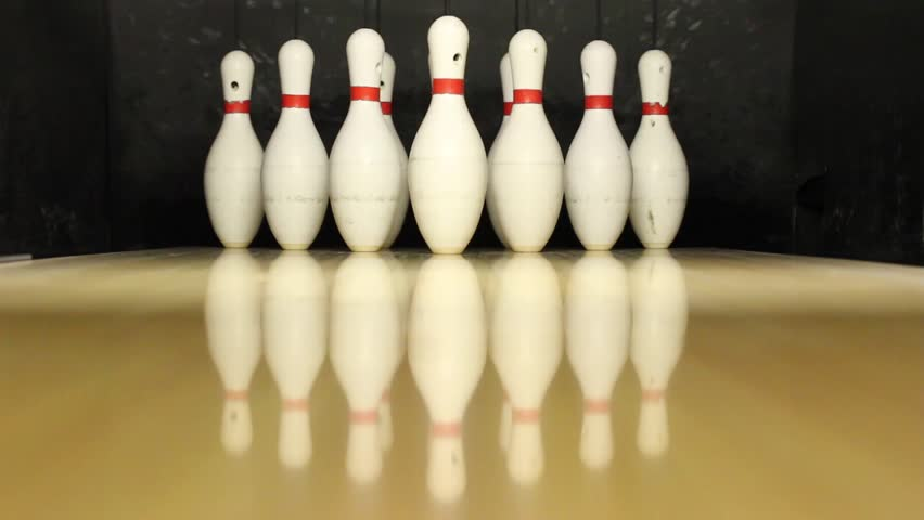 Bowling Pins on Strips Being Knocked Down