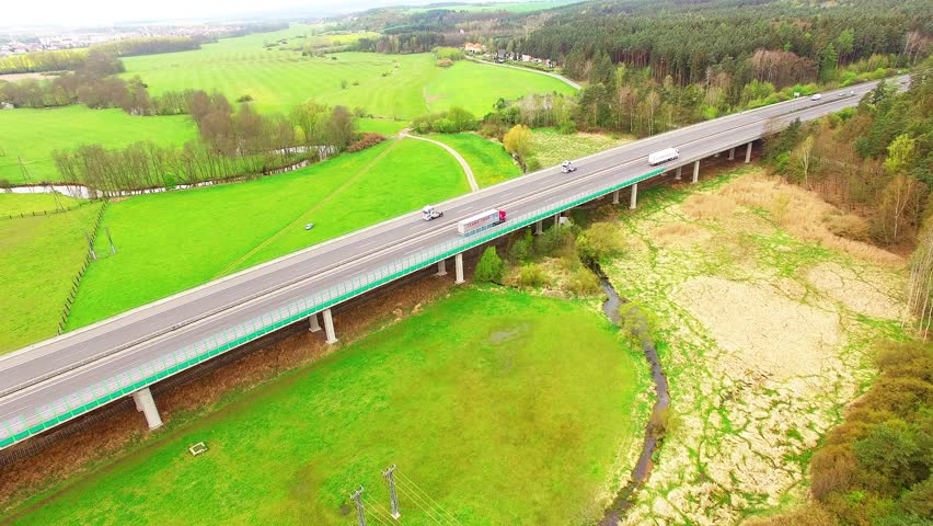 Aerial View Of Bridge Over Radbuza River And Green Pastures. Highway D5  With Traffic Near