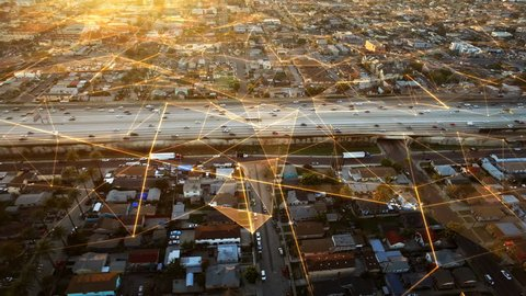 Connected San Francisco Highway with traffic passing by. Sunset. Aerial view. California, United States. Futuristic network. Technology. Transportation.