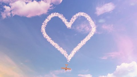 Love is in the air. A heart drawn in the sky by an aeroplane