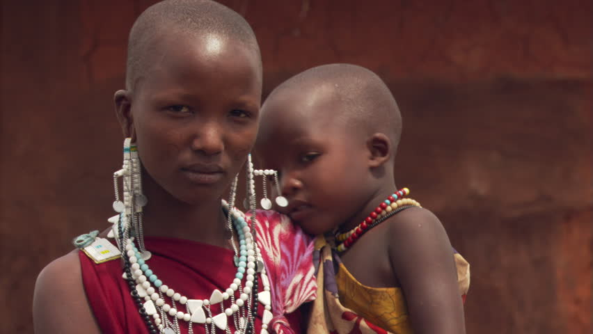 Portrait of young Masai woman and child in Tanzania