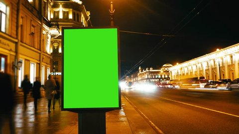 Time Lapse.A Billboard with a Green Screen on a Busy Street.Time Lapse