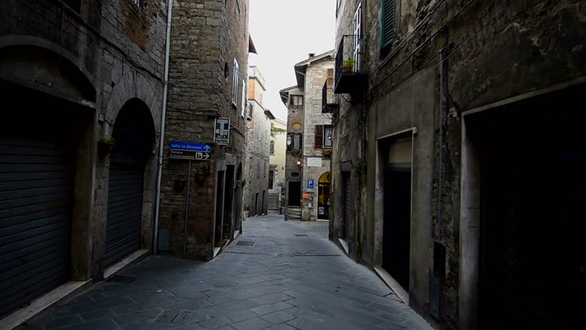 Todi, November 2016: Narrow old italien street, dolly shot. Historic old town of Todi. Todi is a more than 2000 year old city in Umbria. | Shutterstock HD Video #26524886