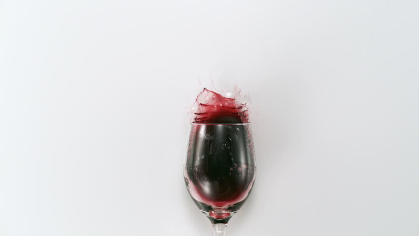 Red wine splashing out of glass shooting with high speed camera, phantom flex.