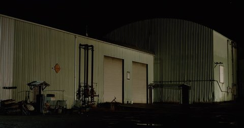 Night industrial warehouse and bay doors