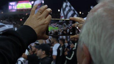 Senior Video Recording a Soccer Game in Sao Paulo, Brazil