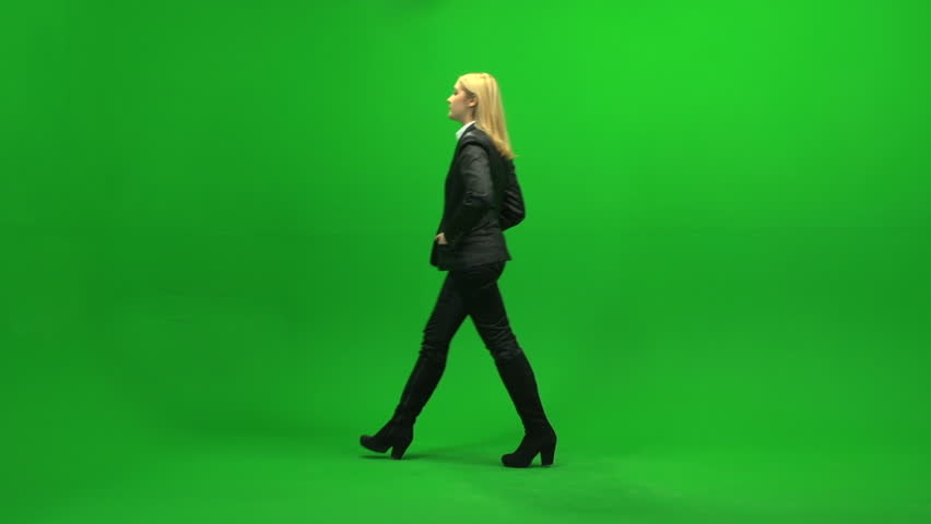 beautiful female sales professional walking into room standing against green screen background. one person isolated