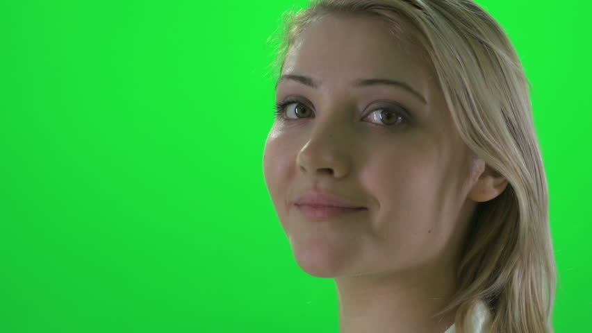 side profile view of young attractive blond women smiling into camera. beautiful female isolated against green screen background