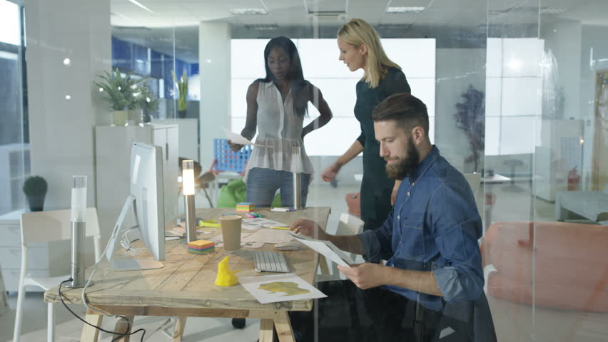 4K Cheerful casual business team working together in modern office